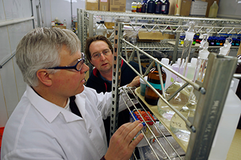 Lance Schideman, research scientist, and John Scott, senior analytical chemist, review chemical stocks