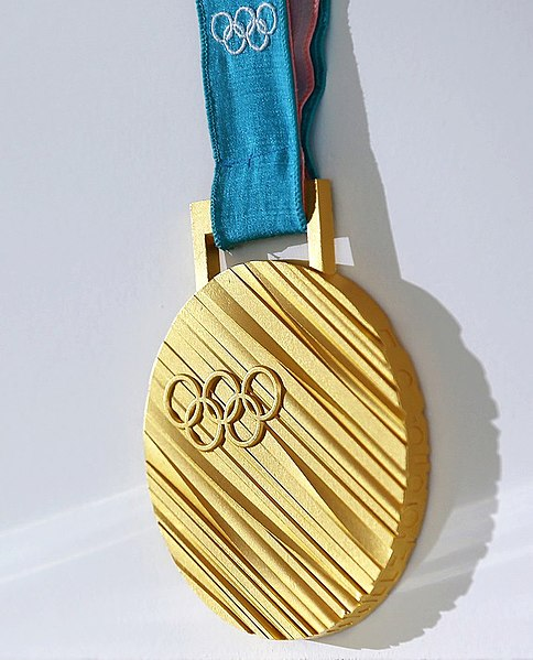olympic gold metal with white background