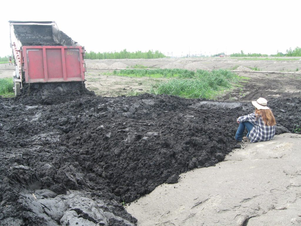 Most sediment was easily handled by trucks and bulldozers, although some was sticky and did not flow smoothly.