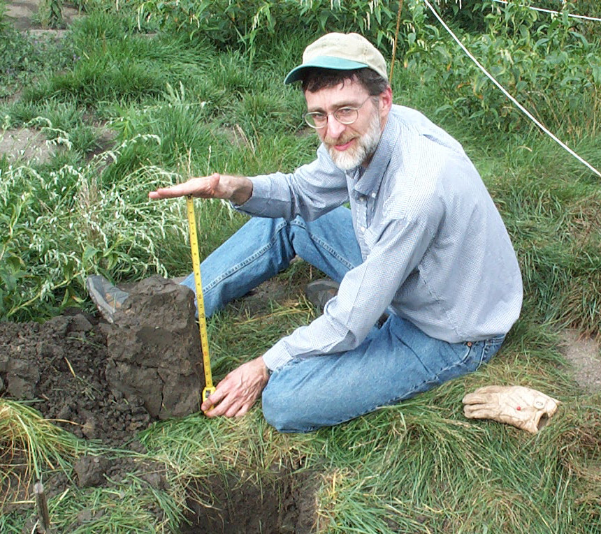 Dr. Robert Darmody, a soil scientist at the University of Illinois, inspects sediment derived topsoil one year after removal from the lake.