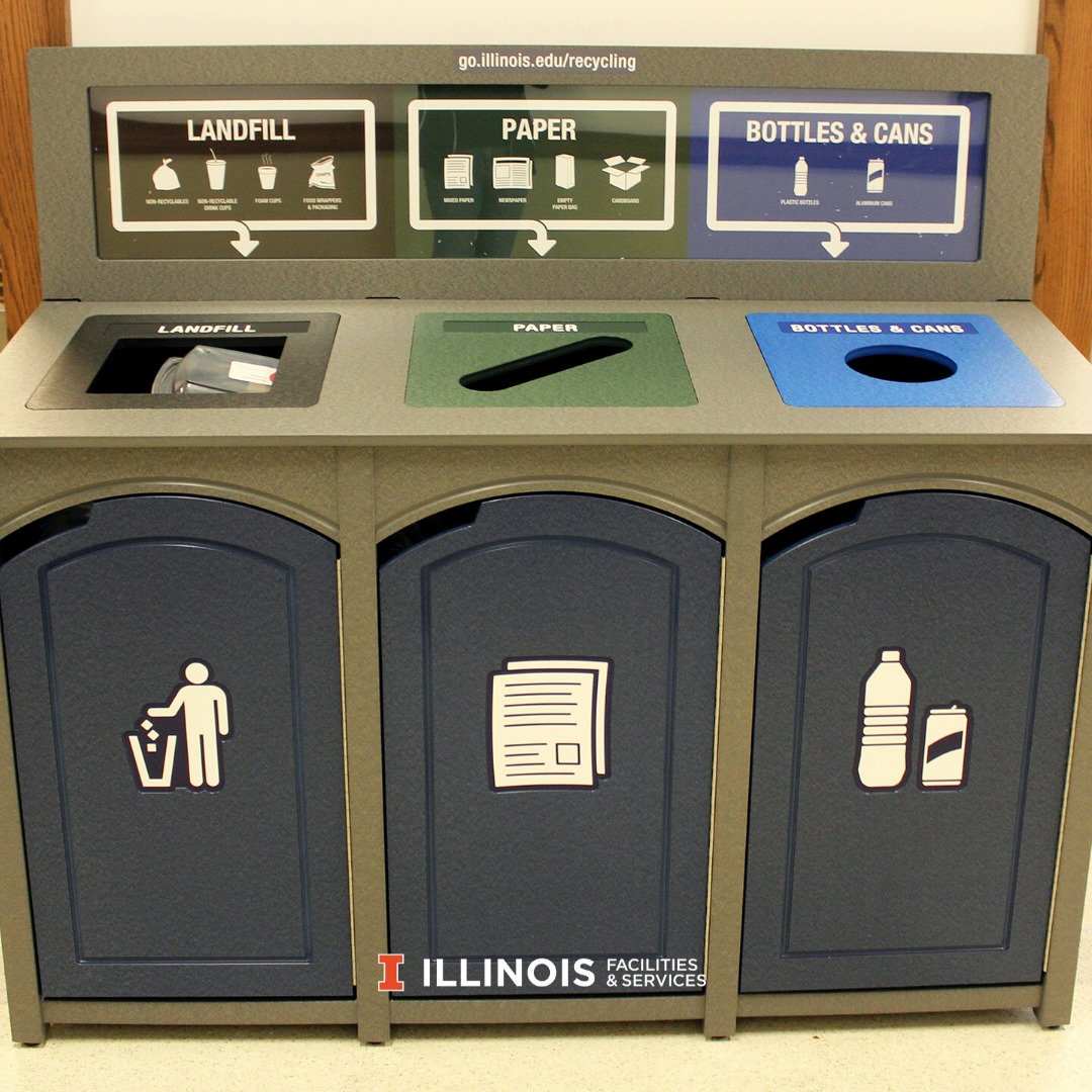 New collection bin station with sections for landfill, mixed paper, and aluminum cans plus bottles