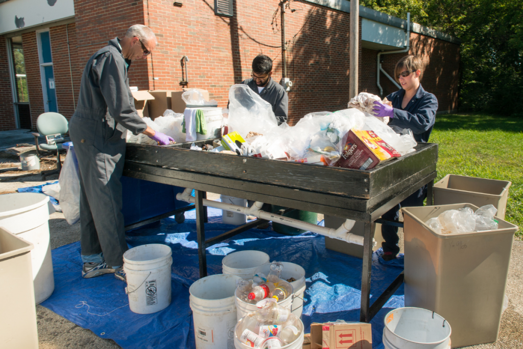 ISTC's applied scientists sort through some of the 7,000 pounds of landfill and recycling-bound materials collected during the ten-day sampling period at Argonne National Laboratory.